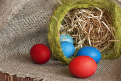 Multi-coloured Easter eggs. On desktop Royalty Free Stock Images