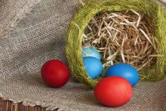 Multi-coloured Easter eggs. On desktop royalty free stock images