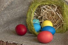 Multi-coloured Easter eggs. On desktop royalty free stock image