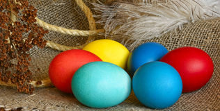 Multi-coloured Easter eggs. On desktop stock photos