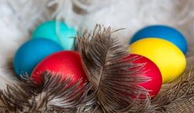 Multi-coloured Easter eggs. On desktop stock photo