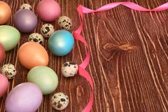 Multi-coloured Easter eggs. Easter eggs on a wooden background Stock Image