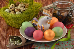 Multi-coloured Easter eggs. Easter eggs on a wooden background Royalty Free Stock Photo