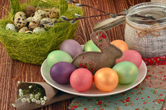 Multi-coloured Easter eggs. Easter eggs on a wooden background Royalty Free Stock Photography