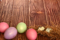 Multi-coloured Easter eggs. Easter eggs on a wooden background Stock Photos