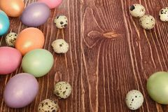Multi-coloured Easter eggs. Easter eggs on a wooden background Stock Photography