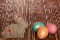Multi-coloured Easter eggs. Easter eggs on a wooden background stock photo