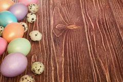 Multi-coloured Easter eggs. Easter eggs on a wooden background stock images