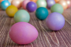 Multi-coloured Easter eggs. Easter eggs on a wooden background royalty free stock images