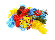 Multi-coloured embroidery threads in a tangled heap Royalty Free Stock Photography