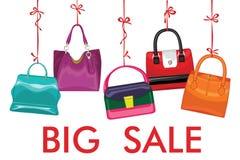 Multi-coloured  fashion women's handbag hang on ribbon.Big sale. Set of Multi-colouredl fashion women's handbag hang on a ribbon.Design template for Big sale Royalty Free Stock Photography