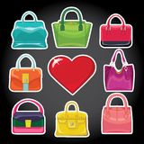 Multi-coloured fashion women's handbag and red heart. Set of Multi-coloured fashion women's handbag red heart standing in front on a black background.Casual and royalty free illustration