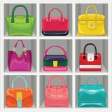 Multi-coloured fashion women's handbag in the wardrobe Stock Photo