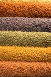 Multi-coloured fluffy carpets. For a background. Multi-coloured floor coverings Royalty Free Stock Photography