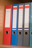 Multi-coloured folders. Stock Photos