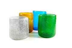 Multi coloured glass cups. Group of multi coloured glass cups on white background Royalty Free Stock Images