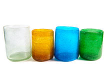 Multi coloured glass cups. Group of multi coloured glass cups on white background Royalty Free Stock Image