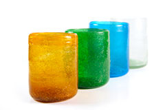 Multi coloured glass cups. Group of multi coloured glass cups on white background Stock Photos