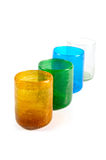 Multi coloured glass cups. Group of multi coloured glass cups on white background Royalty Free Stock Photo
