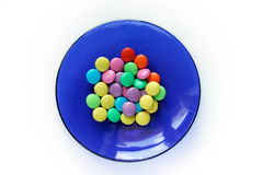 Multi-coloured Goodies On Blue Plate Royalty Free Stock Photo