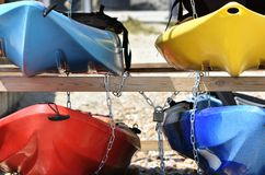 Colourful kayaks on the beach stock images