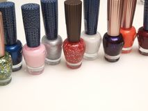Multi coloured nail polish. Bottles of nail polish in different shades & colours Royalty Free Stock Images