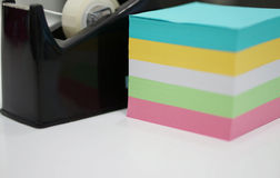 Multi-coloured note pads on desk Stock Images