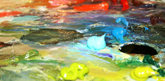 Multi - coloured oily paints. Artists oil paints  multi coloured close up Stock Image