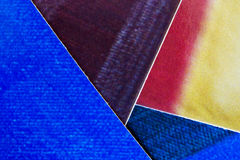 Collage of paper. A background of multi coloured paper Stock Images