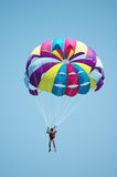 Multi coloured parachute. Over the blue sky Stock Images