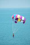 Multi coloured parachute. Over the blue sky Stock Photo