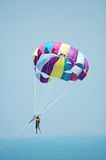 Multi coloured parachute over the blue sky. Multi coloured  parachute over the blue sky Royalty Free Stock Image