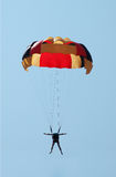 Multi coloured parachute  over the blue sky. Multi coloured parachute over the blue sky Stock Image