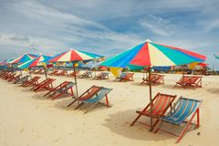 Multi coloured parasols on empty beach royalty free stock image