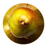 Multi-coloured pear. Fresh pear on a bronze plate Royalty Free Stock Images