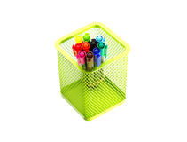 Multi coloured pen in green basket. Multi  coloured pen in basket isolate white background Royalty Free Stock Images