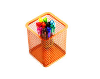 Multi coloured pen in orange basket. Multi  coloured pen in basket isolate white background Royalty Free Stock Photography