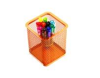 Multi coloured pen in orange basket Royalty Free Stock Photography