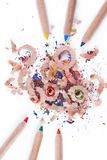 Multi-coloured pencil with crayon shavings Stock Photos