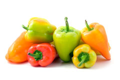 Multi-coloured peppers isolated on white Stock Photos