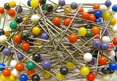Multi coloured pins for craft and hobbies. Photo of multi-coloured pins for use in craft and hobbies Stock Photography