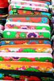 Multi coloured purse. On sale at a asian open air street market royalty free stock photo