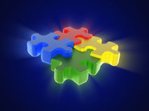 Multi-coloured puzzle on blue background Royalty Free Stock Photos