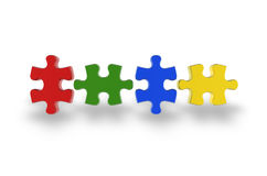 Multi-coloured puzzle isolated on white background Stock Photography