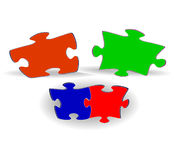 Multi-coloured puzzles on a white background Stock Image