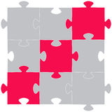 Multi-coloured puzzles on a white background Royalty Free Stock Photo