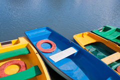 Multi-coloured rowboats Royalty Free Stock Images