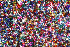 Multi-coloured seed beads. Used in crafts royalty free stock images