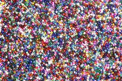 Multi-coloured seed beads. Used in crafts royalty free stock photography