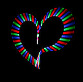Multi-coloured shone heart on black Stock Images
